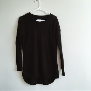 RIPCURL/ Small black round hem sweater